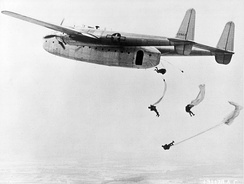 Fairchild C-82 Packet dropping paratroops in training exercise