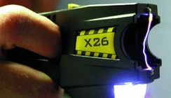 A TASER device, with cartridge removed, making an electric arc between its two electrodes