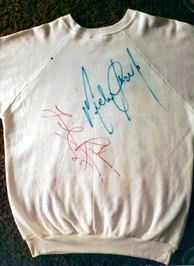 "Back of the ""We Are the World"" sweater autographed by Michael Jackson and Lionel Richie"