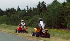 ATVs in New Brunswick, Canada. Note that one of them is plated, an obligation in New Brunswick to legally cross and roll on roads for a maximum of a few hundred meters.