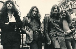 Black Sabbath at Piccadilly Circus, London in 1970. Left to right: Iommi, Ward, Osbourne, Butler