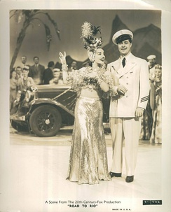 Miranda in a fruit hat and Don Ameche in uniform