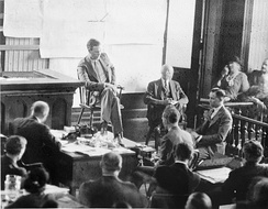 Lindbergh testifying at the Haupt­mann trial in 1935. Haupt­mann is in half-profile at right.