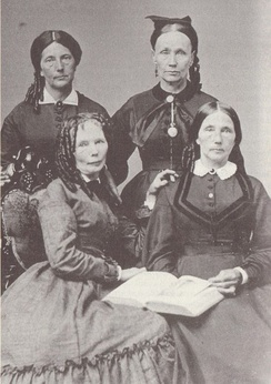 Delia Webster, abolitionist. Delia (front left) with her sisters: Mary Jane (front right), Martha (back left), and Betsey (back right).[1]