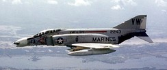 A U.S. Marine F-4B with VMFA-314, flies over South Vietnam in September 1968
