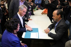 Chicago Mayor Rahm Emanuel assists a constituent apply for US citizenship at Congressman Luis V. Gutierrez's monthly citizenship workshop. Since 1993, Congressman Gutierrez has helped over 50,000 immigrants apply for citizenship.