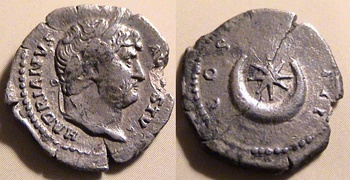 Coin of Roman Emperor Hadrian (r. 117–138). The reverse shows an eight-rayed star within a crescent.