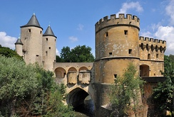 The Germans' Gate from the 13th century, one of the last medieval bridge castles found in France. Today, an exhibition hall
