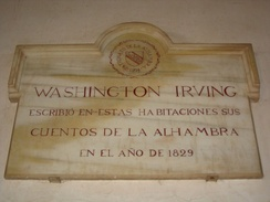 "Commemorative plaque at the Alhambra, saying ""Washington Irving wrote his Tales of Alhambra in these rooms in 1829"" in Spanish"