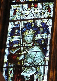 King Alfred the Great pictured in a stained glass window in the West Window of the South Transept of Bristol Cathedral.