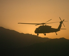 A UH-60 Black Hawk helicopter carries soldiers from the 10th Mountain Division on a mission in Afghanistan.