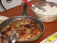 Yassa is a popular dish throughout West Africa prepared with chicken or fish. Chicken yassa is pictured.