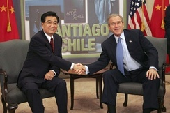 George W. Bush and Hu Jintao of China meet while attending an APEC summit in Santiago de Chile, 2004.