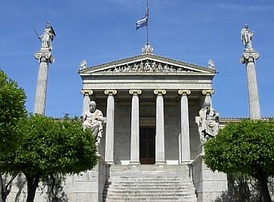The modern National Academy in Athens, with Apollo and Athena on their columns, and Socrates and Plato seated in front.