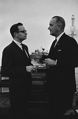 President Johnson (right) meets with special assistant Moyers in the White House Oval Office, 1963