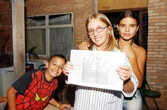 The family of Selma Ferreira was the first recipient of Bolsa Escola, a precursor to Bolsa Família enacted by Governor Cristovam Buarque of the Federal District in 1995.