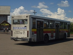 A bus with its registration number displayed in large characters on the back