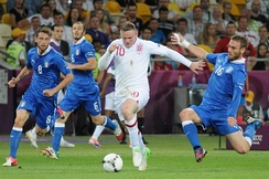 Rooney taking on the Italian defence at UEFA Euro 2012.
