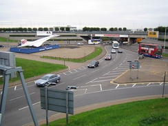 Entrance at the southern end of the M4 Motorway spur, showing a scale model of Concorde, replaced since 2008 by the Emirates A380 scale model.[115]