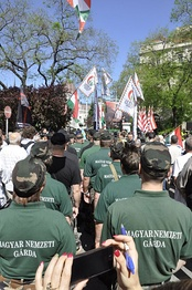Members of the New Hungarian Guard stand at a Jobbik rally against a gathering of the World Jewish Congress in Budapest, 4 May 2013