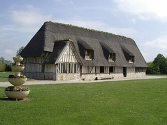 A typical Norman thatched building. This is now a village hall