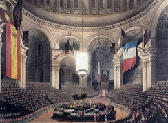 Nelson's coffin in the crossing of St Paul's during the funeral service, with the dome hung with captured French and Spanish flags