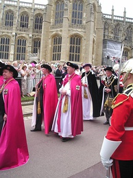 Officers of the Order of the Garter (left to right): Secretary (barely visible), Black Rod, Garter Principal King of Arms, Register, Prelate, Chancellor.