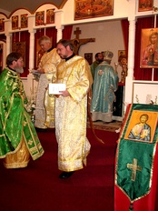 Orthodox Christian clergy: bishop (right, at altar), priest (left), and two deacons (in gold)