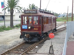 "Waterfront Red Car in San Pedro, California. No. #501 PE ""Huntington"" type wooden streetcar is a replica operated on heritage tracks"