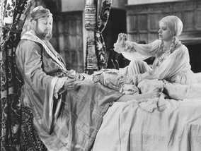 King Henry VIII (Charles Laughton) and Anne of Cleves (Elsa Lanchester) on their wedding night in The Private Life of Henry VIII