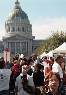 A woman in San Francisco raises her fist, as people in over 60 countries took to the streets on February 15, 2003, in opposition to the imminent invasion of Iraq