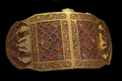 Anglo-Saxon shoulder clasp, with geometric designs and zoomorphic boars on the ends