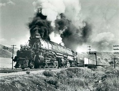 One of UP's Big Boy locomotives hauling a freight train through Echo Canyon, Utah