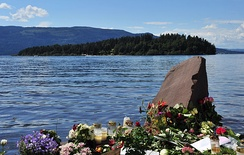 Temporary memorial with Utøya in the background