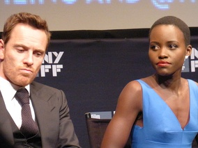 Nyong'o and co-star Michael Fassbender at an event for 12 Years a Slave (2013). Her performance in the film earned her the Academy Award for Best Supporting Actress.