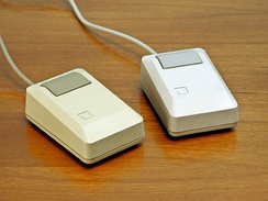 Apple Macintosh Plus mice: beige mouse (left), platinum mouse (right), 1986