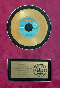 "Gold record presented to Artie Schroeck for his arrangement on ""Can't Take My Eyes Off You"", 1967"
