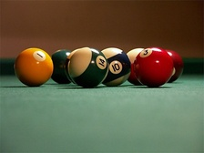Billiards balls hitting each other are a classic example applicable within the science of collision detection.