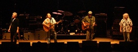 Crosby, Stills, Nash & Young (in photo, from L to R: Nash, Stills, Young, and Crosby) perform at the PNC Bank Arts Center in 2006