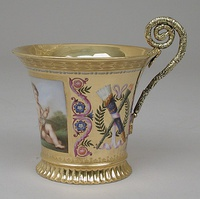 Empire style cup with silver handle from a breakfast service