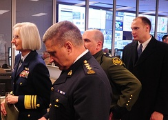 An RCMP chief superintendent (foreground) attends the opening of an Operational Integration Center, alongside representatives of US counterpart agencies.