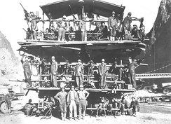 "Workers on a ""Jumbo Rig""; used for drilling Hoover Dam's tunnels"