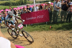 "Adrien Niyonshuti, ""one of the most famous people in Rwanda"",[267] competing in the cross-country mountain biking event at the 2012 Summer Olympics"