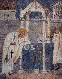 Fresco of Basil the Great, in the church of Saint Sophia, Ohrid. The saint is shown consecrating the Gifts during the Divine Liturgy which bears his name.