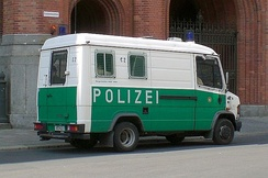 "Mercedes Benz police van in Berlin, nicknamed ""Wanne"" (""Bathtub"") in outdated green livery"