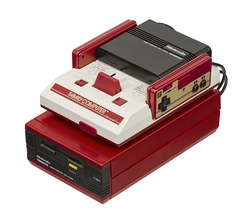 "The Disk System peripheral for the Japanese Famicom, uses games on ""Disk Cards"" with a 3"" Quick Disk mechanism."