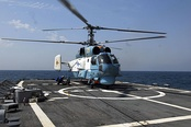 A Ukrainian Naval Aviation Ka-27 preparing for take off from the USS Taylor