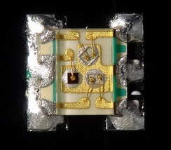 Very small (1.6x1.6x0.35 mm) red, green, and blue surface mount miniature LED package with gold wire bonding details.