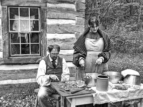 A re-enactment of Norwegian farmers making head cheese in Wisconsin.