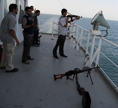 Private guard escort on a merchant ship providing security services against piracy in the Indian Ocean.